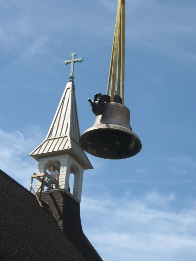 Restored Meneely Bell from 1911 is hoisted into restored steeple