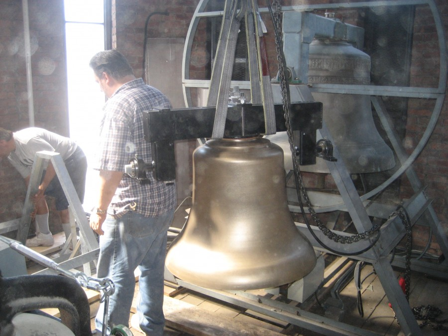 New 800 lb. Bronze Bell being lifted into position at St. John The Evangelist Church