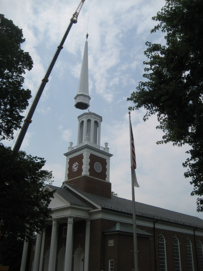 The Steeple spire is added and bolted in place