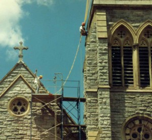 Steeplejacks performing masonry repairs