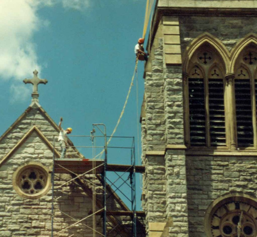 Steeplejacks performing masonry repairs