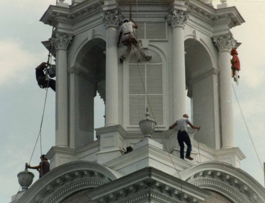 Steeplejacks restoring a historic church steeple