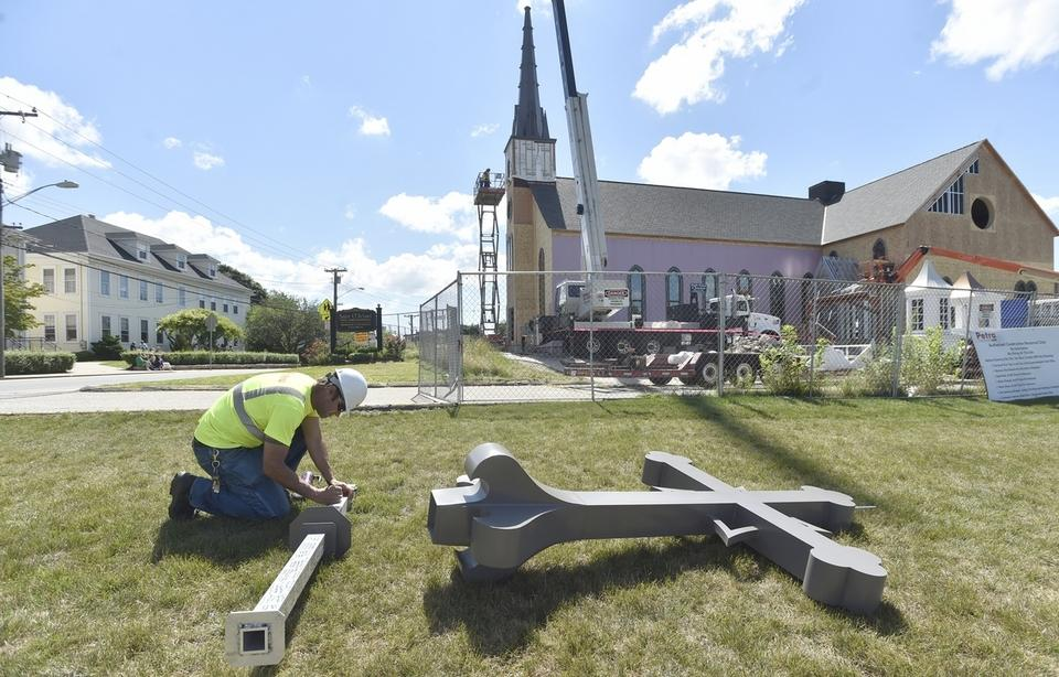 Rebuilding of St. Michael Church hits milestone with placing of Steeple & Cross
